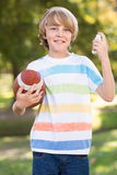 Little boy using his inhaler Stock Image