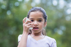 Little boy using his inhaler Royalty Free Stock Photography