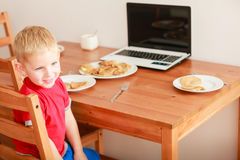Little boy using laptop computer playing games Royalty Free Stock Photo