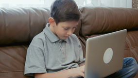 Little boy using laptop computer. And typing chatting on the social networks stock video