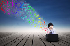 Little boy using a laptop outdoor Royalty Free Stock Photos