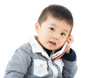 Little boy using mobile Stock Images
