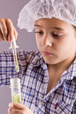 Little boy using a pipette and test tube Royalty Free Stock Image