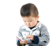 Little boy using smartphone Royalty Free Stock Images
