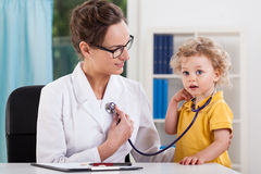 Little boy using stethoscope Royalty Free Stock Photography
