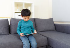 Little boy using tablet computer Royalty Free Stock Images