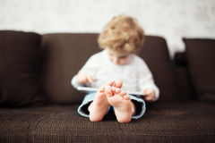 Little boy using tablet computer Royalty Free Stock Photos