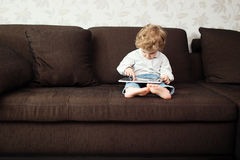 Little boy using tablet computer Stock Photo