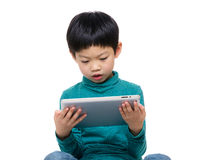 Little boy using tablet computer Royalty Free Stock Photography