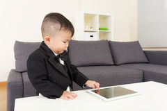 Little boy using tablet Stock Images