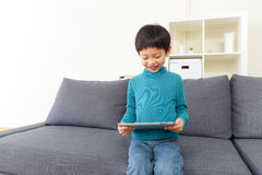 Little boy using tablet Stock Photos