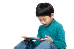 Little boy using tablet Stock Photo