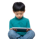 Little boy using tablet Royalty Free Stock Photos