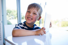 Little boy using tablet pc Stock Images