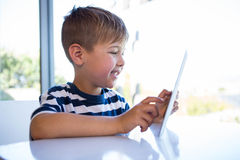 Little boy using tablet pc Royalty Free Stock Photography