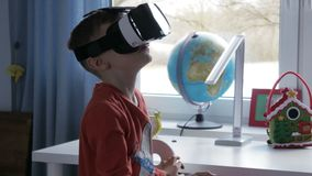 Boy in virtual reality goggles playing 360 degree game - 4k stock footage