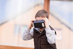Little boy using VR virtual reality goggles Stock Photo