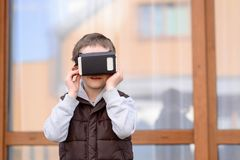 Little boy using VR virtual reality goggles Royalty Free Stock Image
