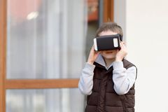 Little boy using VR virtual reality goggles Stock Photos