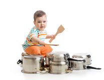 Little boy using wooden spoons to bang pans drumset Royalty Free Stock Photos