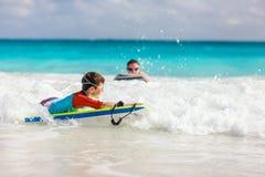 Boy swimming on boogie board. Little boy on vacation having fun swimming on boogie board stock image