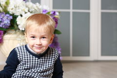 Little boy and a vase Royalty Free Stock Photos