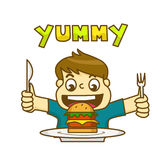 Little boy is very happy to eat delicious hamburger Royalty Free Stock Images