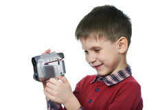 Little boy with video camera isolated Stock Photography