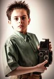 Little boy with a vintage camera stock photography