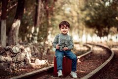 Little boy in vintage closes stock photo