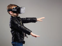 Little Boy in virtual reality glasses playing the game Royalty Free Stock Photos