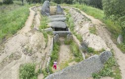 Little boy visitor discovering Dolmen of Lacara, Ancient megalit royalty free stock photos