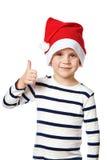 Little Boy w Santa kapeluszu z aprobatami podpisuje ok odizolowywa Obraz Royalty Free