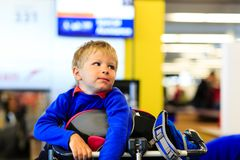 Little boy waiting in the airport Stock Photos
