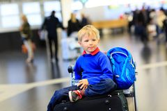 Little boy waiting in the airport Royalty Free Stock Photography