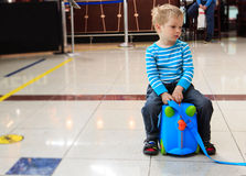 Little boy waiting in the airport Stock Photography
