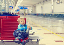 Little boy waiting in the airport Stock Images