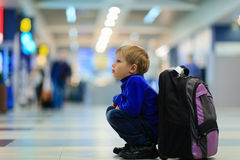 Little boy waiting in the airport Royalty Free Stock Images