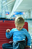 Little boy waiting in the airport Stock Photo