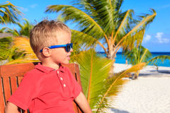 Little boy waiting in cafe on tropical resort Stock Photo