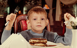 Little boy waiting to tuck into his dessert Royalty Free Stock Images