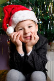 Little boy waiting under the chistmas tree Royalty Free Stock Photography