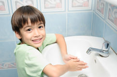 Little boy waiting for washing hand Royalty Free Stock Photo