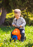 Little boy walk on the bike Stock Image