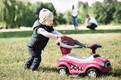 Little boy on a walk in the Park on a spring day. The concept of active recreation stock photography