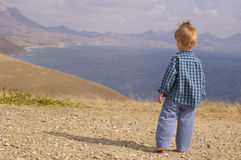 Little boy walk in summer mountain Stock Photos