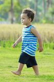 Little boy walking Royalty Free Stock Photo