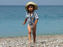 Little boy walking beach Stock Photos