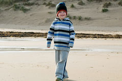 Little boy walking on the beach Royalty Free Stock Photography