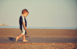 Little boy walking on the beach Stock Photography